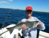 Women catch stripers on Summer Job Charters!